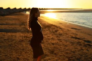 Birth Mother on Beach thinking about the Adoption Process